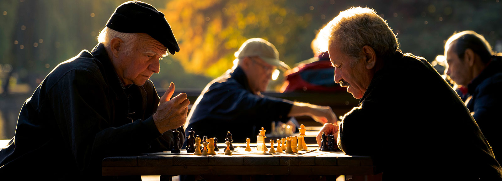 older men playing chess